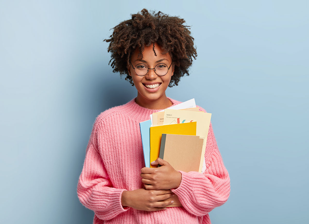 young black woman holding books